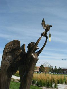 """The statue of """"Grace"""" at the Thornton Veterans Memorial in Colorado. The dog tags read: """"In defense of our freedom, you have sacrificed all. Our hearts will always remember.""""    Good to remember this Memorial Day."""