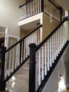 One of our two staircases, now the railings have been painted a black matte finish. Kept the spindles white. Thought I'd try this before replacing the whole thing with wrought iron. I love how it turned out. Much less time consuming and significantly less expensive than replacing too!