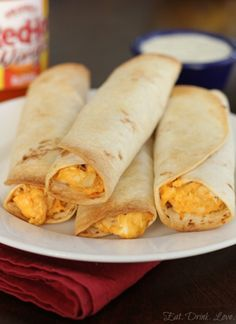 Baked Buffalo Chicken Taquitos I used leftover shredded buffalo chicken and didn't add the hot sauce. So good!