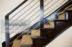 Wooden and metal handrail along carpeted staircase - Stock Photos ...