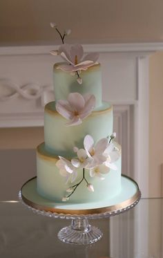 Don't care for the flowers but the fondant colour and gold trim on each tier is beautiful!