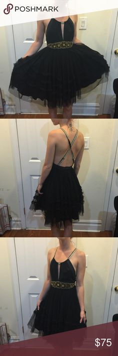 FREE PEOPLE Golden Embellished Tulle Ruffle Dress FREE PEOPLE Gorgeous dress with golden embellishments and beading detail- top chest area has a mesh like feel and the straps are adjustable. Size 2. Bottom half is ruffled tulle and is SUPER awesome! Free People Dresses
