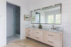 A limited palette of greys and whites. Limed floors and boards on the walls. Rich timber and ma...