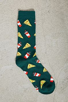 A pair of knit crew socks with an allover pizza and soda pattern.