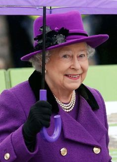 Queen Elizabeth II in purple. Queen Elizabeth II is smiling. Die Queen, Hm The Queen, Her Majesty The Queen, Save The Queen, Purple Love, All Things Purple, Shades Of Purple, Purple Hues, Fascinator Wedding