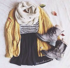 Striped shirt/sweater paired with a yellow sweater, black skirt, circle scarf, and combat boots. Maybe even wear tights
