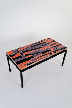Decorative low table with enameled top and iron structure, manufactured in Italy in the late '50s