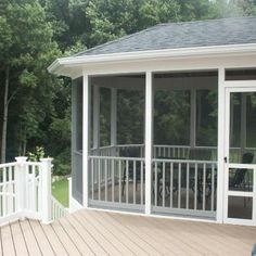This lovely screen porch is wrapped in white aluminum for low maintenance. The deck is composite with white vinyl railing. Notice the angles on the porch which create interest.