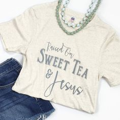 "This is a super-soft unisex tee with our ""Raised on Sweet Tea & Jesus"" design. Fit: Unisex and runs true to size. *Tri-Oatmeal with grey/silver design. Size Bust/Chest Inches XS 30-32 Small 34-36 Medi"