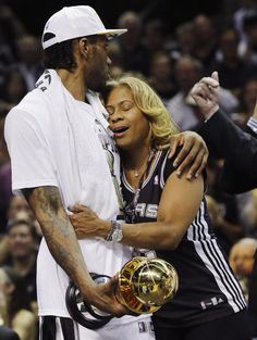 San Antonio Spurs win NBA title in five games over Miami Heat - Most Valuable Player San Antonio Spurs forward Kawhi Leonard celebrates with his mother, Kim Leonard, after Game 5 of the NBA basketball finals against the Miami Heat on Sunday, June 15, 2014, in San Antonio. The Spurs won the NBA championship 104-87. (AP Photo/David J. Phillip)
