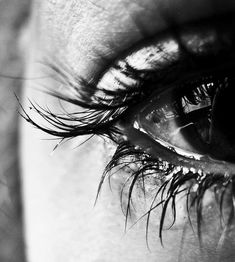 close up to an eye full of tears