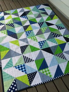 fun colors!  Geometric Navy and Lime Handmade Modern Cot Crib Patchwork Quilt with white in triangles for Baby Nursery.  via Etsy.