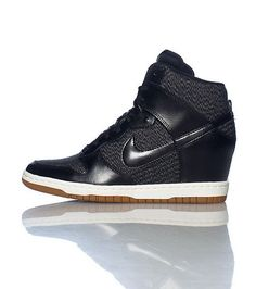 NIKE High top women's wedge sneaker Lace up closure Mesh for breathability Padded tongue with NIKE logo Cushioned inner sole