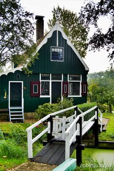 Zaanse Schans, Holland. An outdoor museum of old Dutch life. It was magical & quaint with lots of windmills.