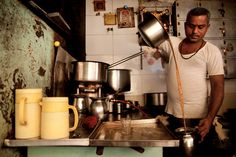 Gowda, a chai wallah, makes traditional Indian chai near the Bhuleshwar neighborhood in Mumbai. The tea is made with boiled milk and spices and served in small cups on the street. India Culture, Tea Culture, Chai, Drinking Around The World, Vintage India, Pastry Shop, Starbucks Coffee, Incredible India, Drinking Tea