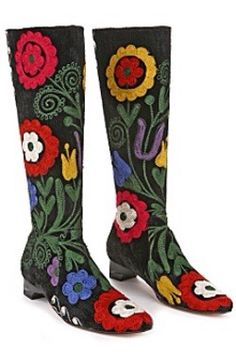 The design of these boots by Anthropologie seems to have been influenced by vintage embroidered boots of the and In fact they are actually made out of vintage Suzani fabric. The boots are black velvet and are abloom with boldly colored floral embroidery. Vintage Boots, Vintage Outfits, Vintage Fashion, Vintage Clothing, Boho Boots, Casual Boots, Heeled Boots, Bootie Boots, Suzani Fabric