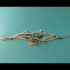 Juicy Couture Multi Charm Bracelet Used but in good condition Juicy Couture Jewelry Bracelets
