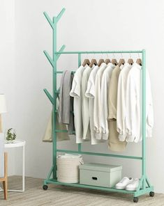 14 clothes racks that store your garments in style - Living in a shoebox Clothes racks are excellent storage solutions for bedrooms, entryways, laundry rooms and guestrooms. They give you easy access to all your garments, and they ar Standing Clothes Rack, Standing Closet, Large Shelves, Storage Shelves, Storage Spaces, Clothes Stand, Clothes Racks, Clothes Rack Bedroom, Oak Clothing