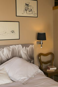 ROOM is a wall lamp with LED reader. It light up your room, you don't need more space in your bedside table for a lamp.