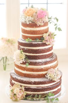 www.KUCHENmitSTIL.at - The finest pastry -  love our 4 tier semi naked cake with fresh flowers. Perfect for a boho or vintage summer wedding!