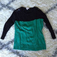 Merona black and green color block sweater A sophisticated color combination of black and Kelly green make this sweater an easy and put together choice for work or weekend. Decorative button detail on each shoulder. Merona Sweaters Crew & Scoop Necks