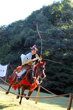 Yabusame - Japanese traditional horseback archery . Rad! I wonder if this is legal in my state for hunting big game?  I need to get my horse trained!