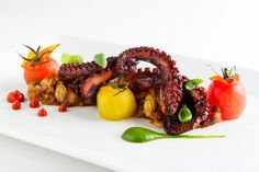 Healthy braised Spanish octopus over eggplant caponata with cherry tomatoes, basil purée and a paprika vinaigrette. Available at Rouge Tomate!