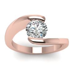 Round Cut Diamond Engagement Rings With White Diamonds In 14k Rose Gold | Central Twist Ring | Fascinating Diamonds