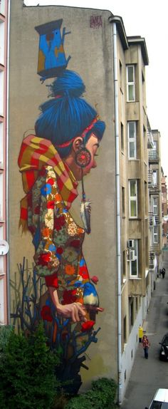Colorful street art in Lodz, Poland created by street artist Sainer. The…