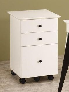 "White finish wood modern style mobile cart with casters and 3 drawers. Measures 16"" x 20"" x 27"" H. Some assembly required. SKU 	801064"