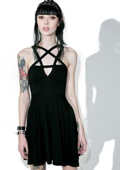 Killstar Magi Penta Skater Dress get ready to head off to witch academy, bb! Hone yer skills in this badass lil sleeveless dress, featuring a super comfy 'n stretchy fit, soft pleating fer a flowy skirt, scoop back, and pentagram strap details across tha chest.