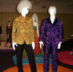 Noel Redding (of the Jimi Hendrix Experience) mannequin wears a Granny Takes a Trip jacket in fabric by Morris & Co. designed by John Pearse in about 1967. On the right, a Granny Takes a Trip velvet suit from the early 1970s.- Joyatri