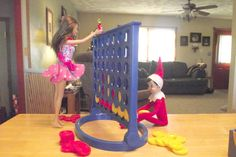 Elf on the shelf ideas - playing Connect 4 with Barbie Bad Elf, Awesome Elf On The Shelf Ideas, Christmas Preparation, Christmas Elf, Pottery Barn Kids, Merry And Bright, Boy Or Girl, Shelf Elf, Christmas Decorations
