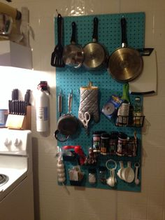 Buy pegboard...Buy a sample size of paint... And hardware hooks for pegboard from lowes and hang. for an easy diy apartment storage solution. I think this altogether cost me around 20$ and it makes my tiny kitchen way more manageable.