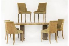 An Art Deco walnut dining room suite,comprising:a dining table and six chairs