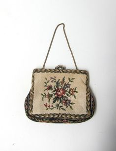 Vintage retro 1960s cream floral rose tapestry formal evening purse. $24.20, via Etsy.