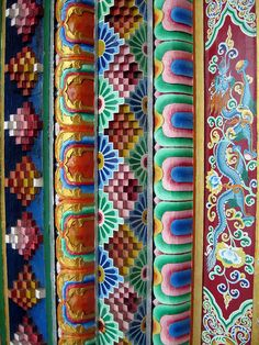 Detail of hand crafted, hand painted door at Tibetan Buddhist monastery in Bir Tibetan Settlement, HP state, India Copyright Tammy Winand. Images of Himalayan cultures