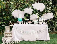 This dream inspired first birthday party is the cutest! Skybox Events turned a backyard into a fluffy white cloud where this little one could reign on his special day.