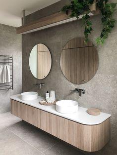 Amazing rounded vanity using polytec's Natural Oak Ravine laminate with matching overhead light.