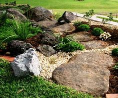 Boulder Landscaping Ideas | Landscape Rock Boulders and Making Concrete Rocks. Another nice use of boulders, but don't you agree that it needs some color?