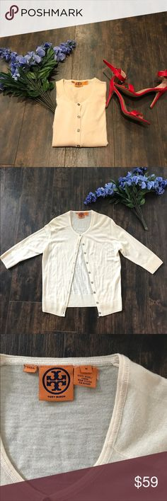 Authentic Tory Burch Cream Cardigan Excellent condition, no pilling. 100% wool. Measures 16 inches armpit to armpit and 23.5 inches shoulder to hem. Smoke free, pet friendly home. Tory Burch Sweaters Cardigans