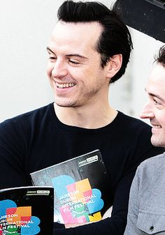 Andrew Scott - the prettiest man in the world<< who looks pissed in this photo.