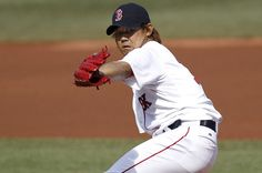 BOSTON, MA: Daisuke Matsuzaka #18 of the Boston Red Sox pitches against the Washington Nationals during the first inning of the game at Fenway Park in Boston, Massachusetts. (Photo by Winslow Townson/Getty Images)