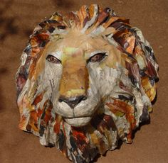 Papier Mache Lion, not sure if this is a mask or a wall piece, but they really captures the kingliness of this magnificent creature, and a real lion did not have to die in order for it to be created.