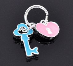 Moveable Silver Plated Enamel Heart and Key Charm by SmartParts, $4.99
