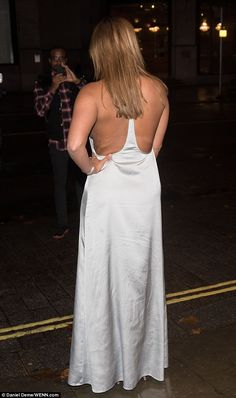 Dressing to impress: Going bra-less for the occasion, she left little to the imagination in the barely-there dress, which also featured backless detail. Ferne Mccann, Floor Length Dresses, In The Flesh, Silk Dress, Dress To Impress, Imagination, Boobs, Backless, Dressing