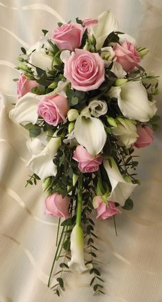 roses and calla lilys with freesia shower bouquet  www.weddingflowersbylaura.com
