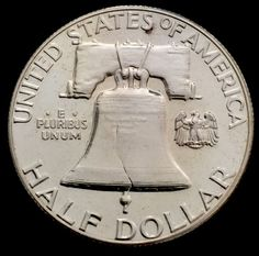 1957 Uncirculated Brilliant Proof Philadelphia Franklin Silver Half Dollar.