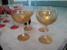 Handpainted wine goblets, white & gold with crystals on base. $60 set of 4. harrisartstudio.com