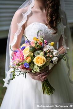 Bright and colorful yellow, pink and purple wedding bouquet {Thirteenth Moon Photography LLC} Purple Wedding Bouquets, Bridesmaid Bouquet, Wedding Flowers, Bridal Bouquets, Wedding Dresses, Wildflower Centerpieces, Wedding Flower Arrangements, Park Weddings, Real Weddings